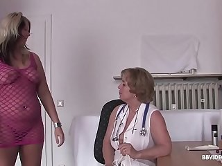 German doctor checks lesbian pussy before dildo treatment