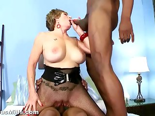 Horny granny gets fucked by two black cocks
