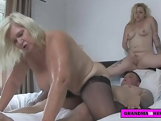 grandma and her friend play with the delivery guy