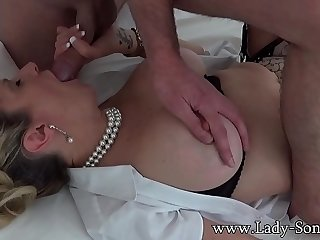 Busty mature blonde Lady Sonia sucking off a masked man