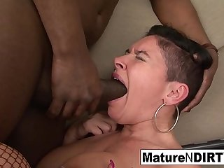 Granny uses a toy to help fit a big black cock in her ass