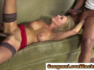 Blonde cougar in stockings gets fucked