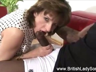 Horny mature Lady Sonia sucks on cock