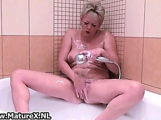 Blonde mature lady loves playing