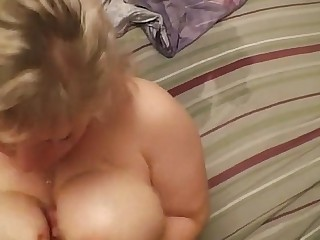 Mom gives son handjob.